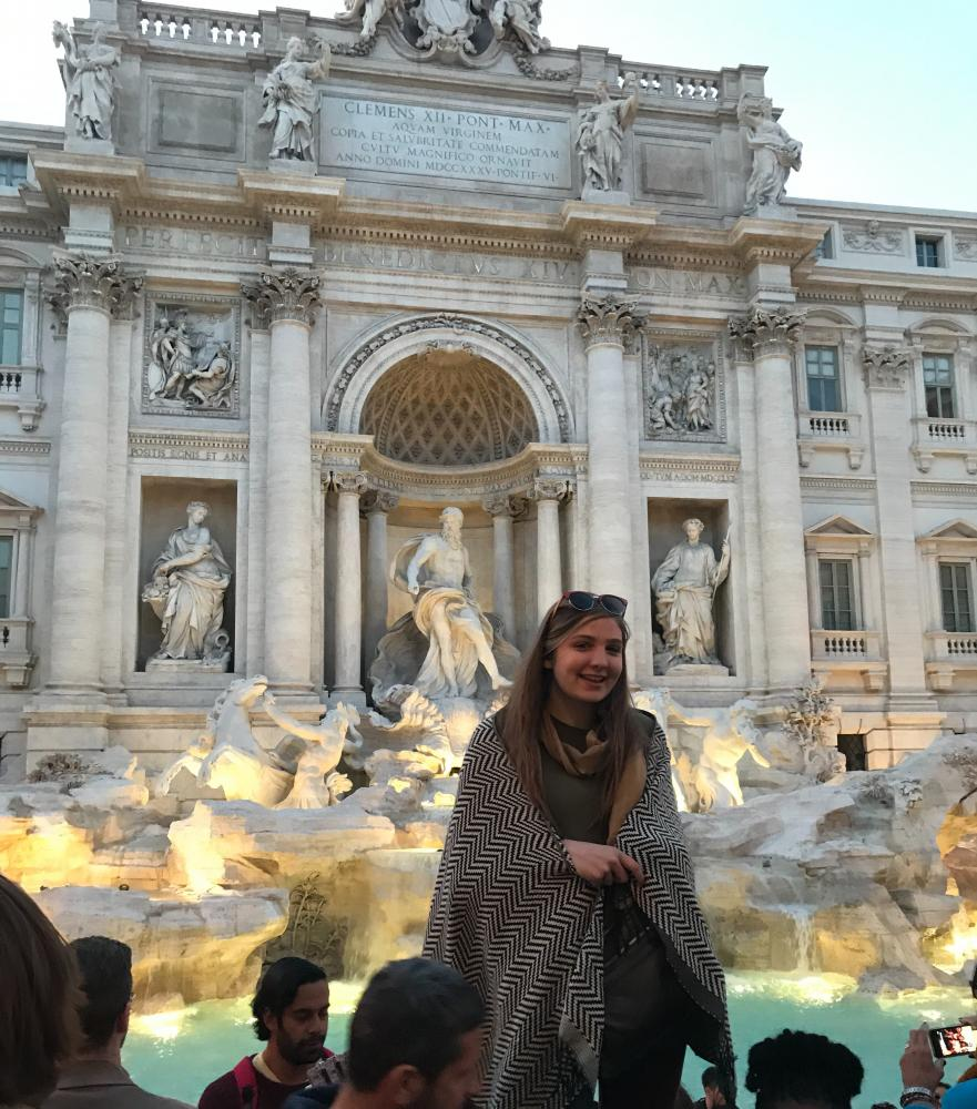 Milligan in front of the Trevi Fountain in Rome, Italy.